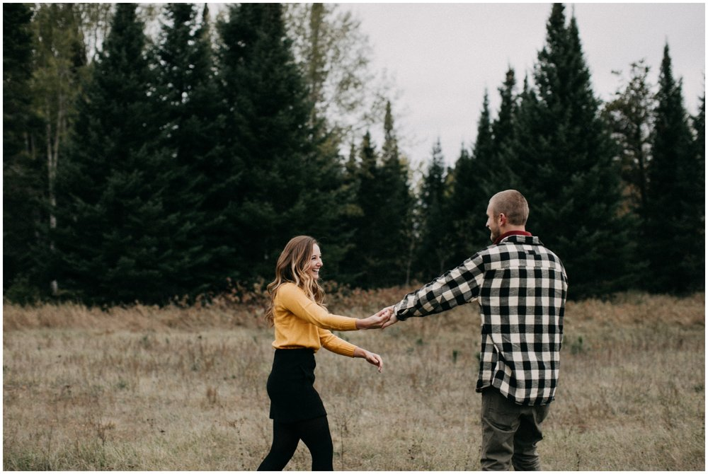 Candid outdoor fall engagement session in Hackensack, MN engagement