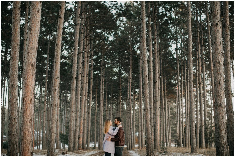 Winter engagement session in the north woods of Minnesota photographed by Britt DeZeeuw