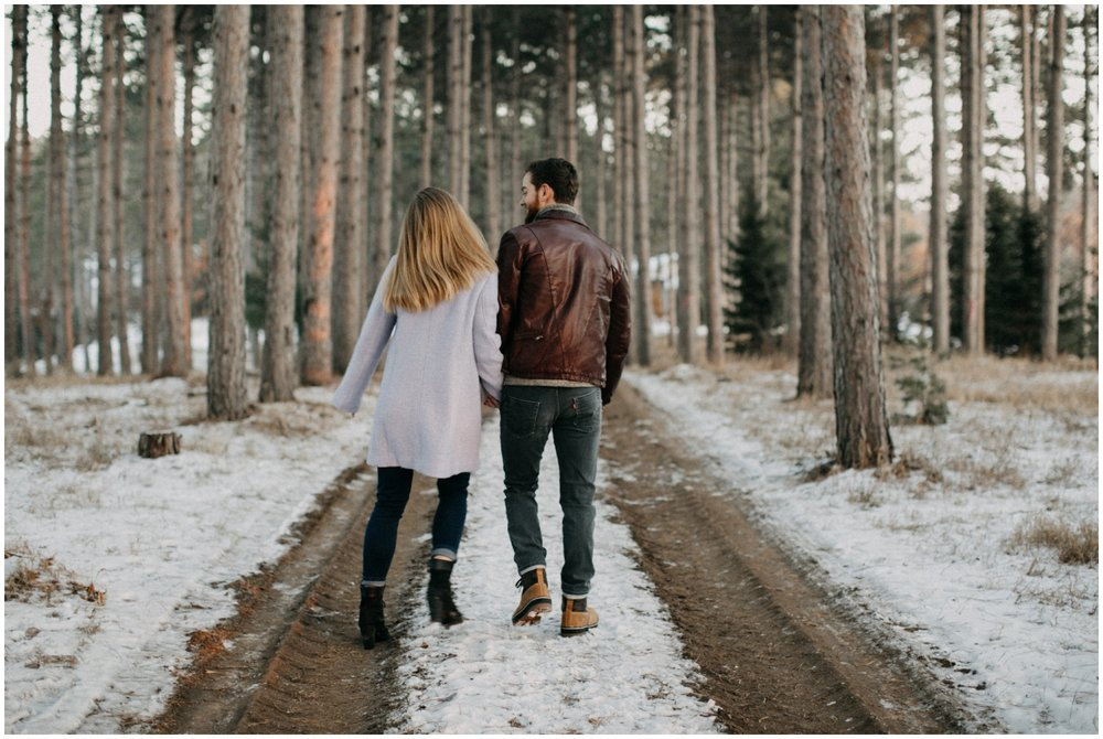 Towering pine tree forest engagement session by Minnesota wedding photographer Britt DeZeeuw
