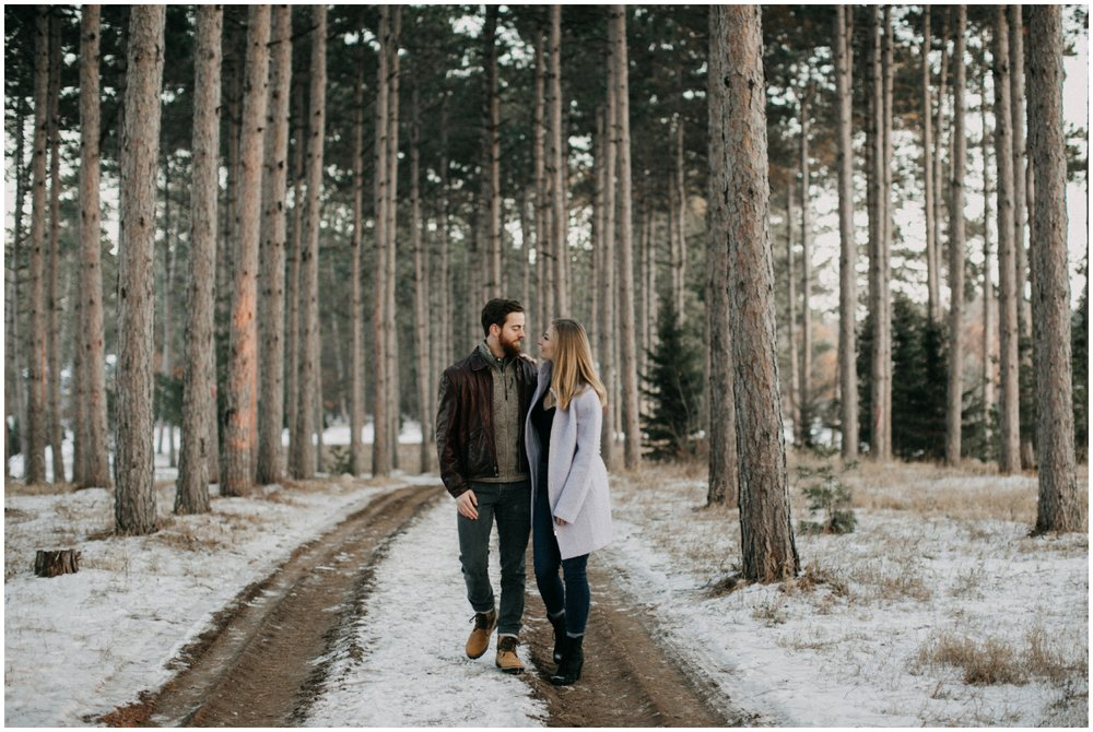 Snowy, pine tree forest engagement session by Minnesota wedding photographer Britt DeZeeuw