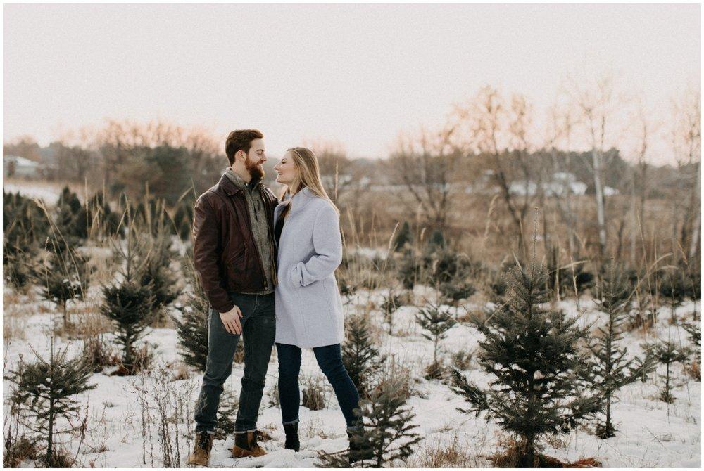 Winter engagement photography at Hansen Tree farm in Minnesota