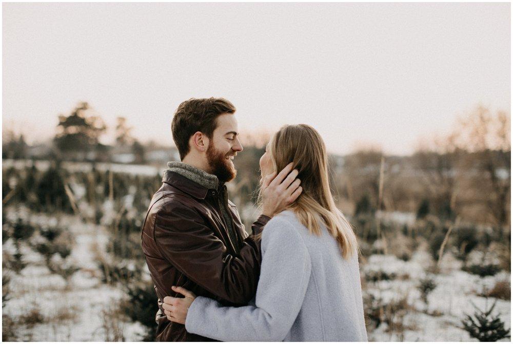Outdoor Minnesota winter engagement session photographed by Britt DeZeeuw