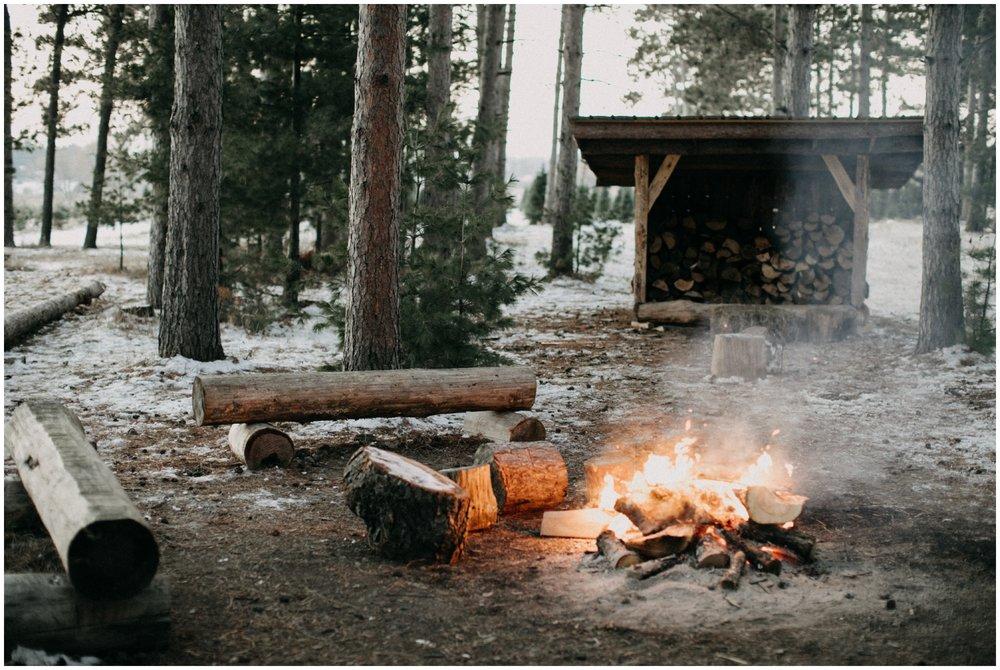 Winter bonfire engagement session at Hansen Tree Farm in Minnesota
