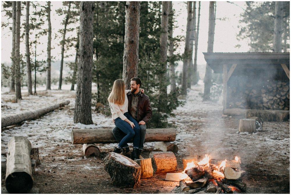 Outdoor winter campfire engagement session by Britt DeZeeuw Brainerd Minnesota photographer
