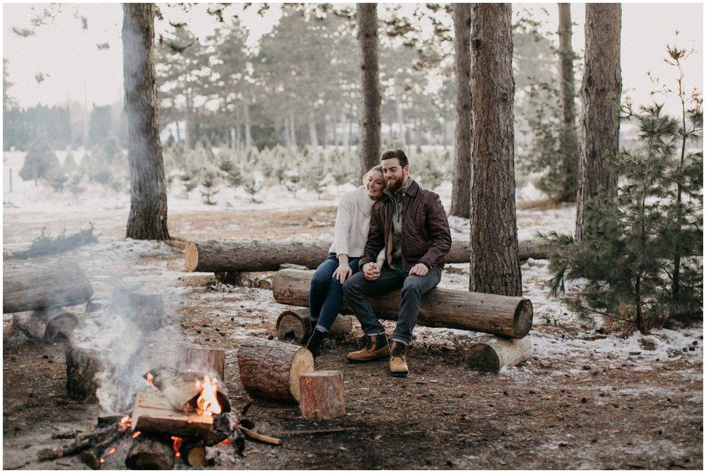 Winter bonfire engagement photography at Hansen Tree Farm in Anoka, MN