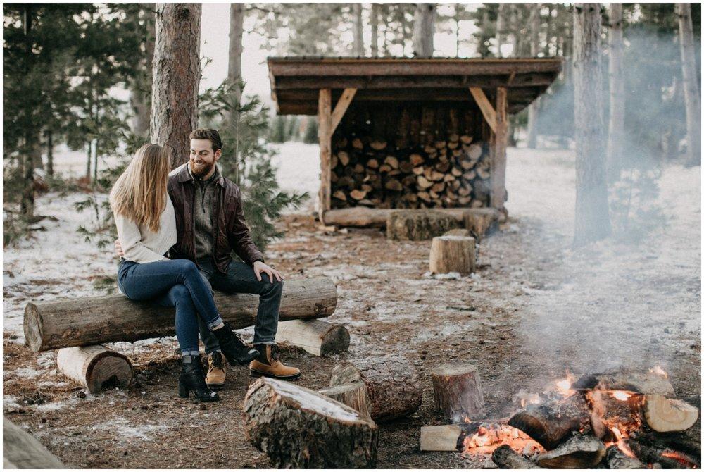 Winter bonfire engagement session photographed by Britt DeZeeuw