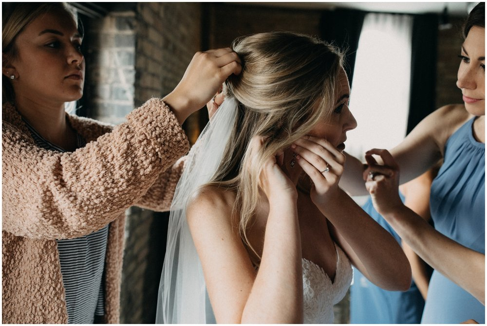 Candid wedding photography of bride getting ready the Hewing Hotel in Minneapolis