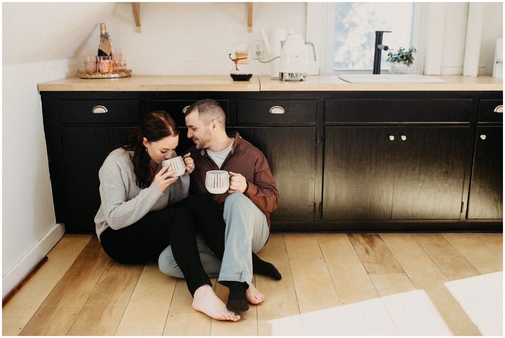 Couple having coffee in Minneapolis home engagement session