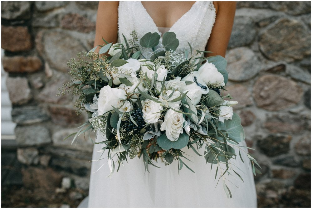 Gorgeous white rose and eucalyptus bridal bouquet at Camp Foley wedding