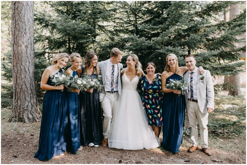 Candid family wedding portrait at Camp Foley in Pine River, MN