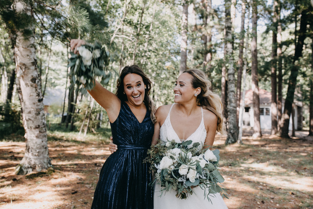 Bride with sister at Camp Foley wedding in Pine River MN