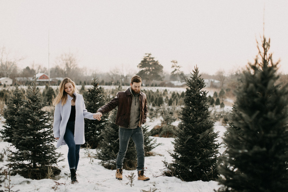 Christmas tree farm winter engagement session in Minnesota