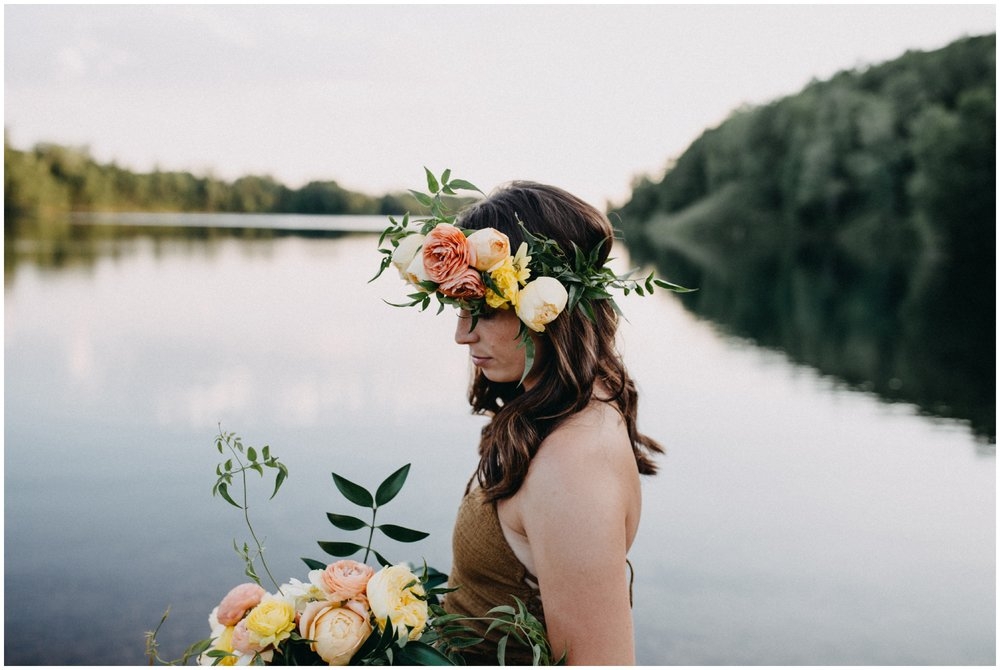 Water portrait session with lush summer flower crown and bouquet