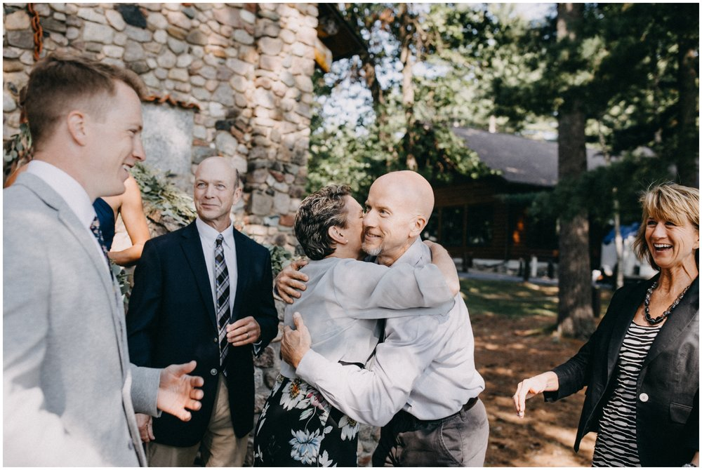 Candid family photo at Camp Foley wedding in Pine River Minnesota