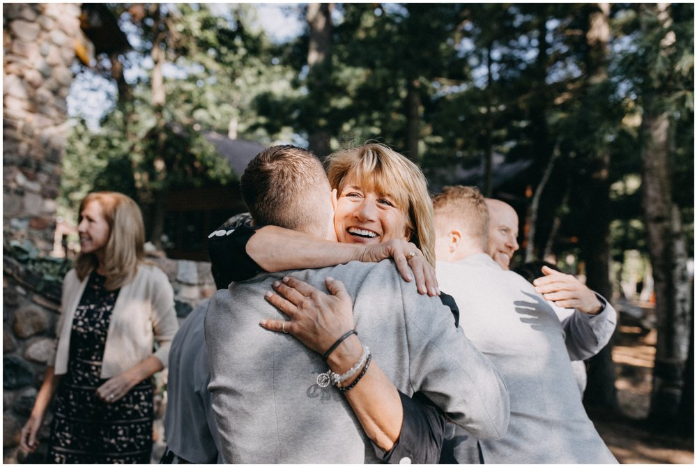 Unposed and natural family photo at Camp Foley wedding in Pine River MN