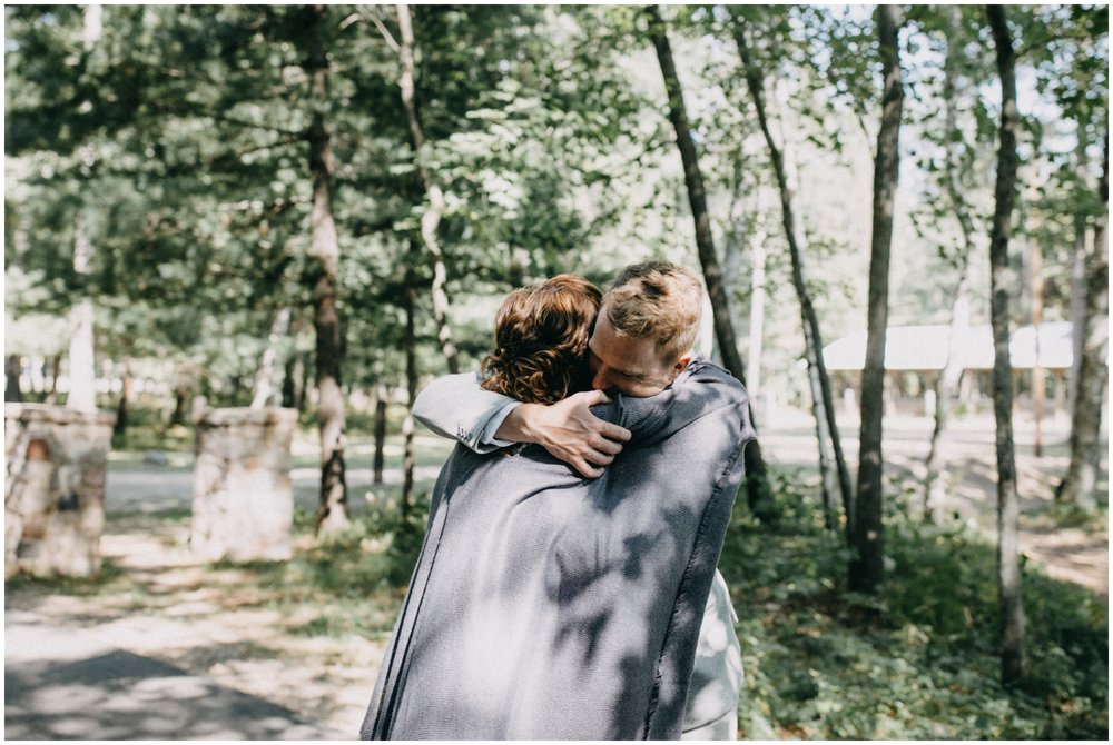 Emotional and unscripted family photo at Camp Foley wedding