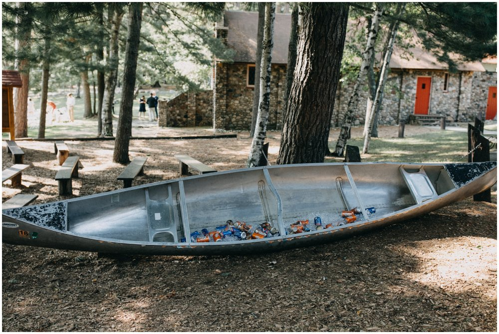 Summer camp theme wedding with canoe cooler