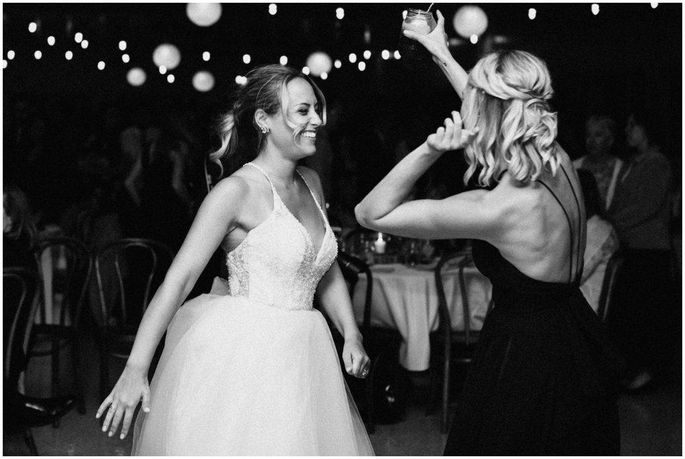 Bride dancing at Camp Foley wedding in Pine River