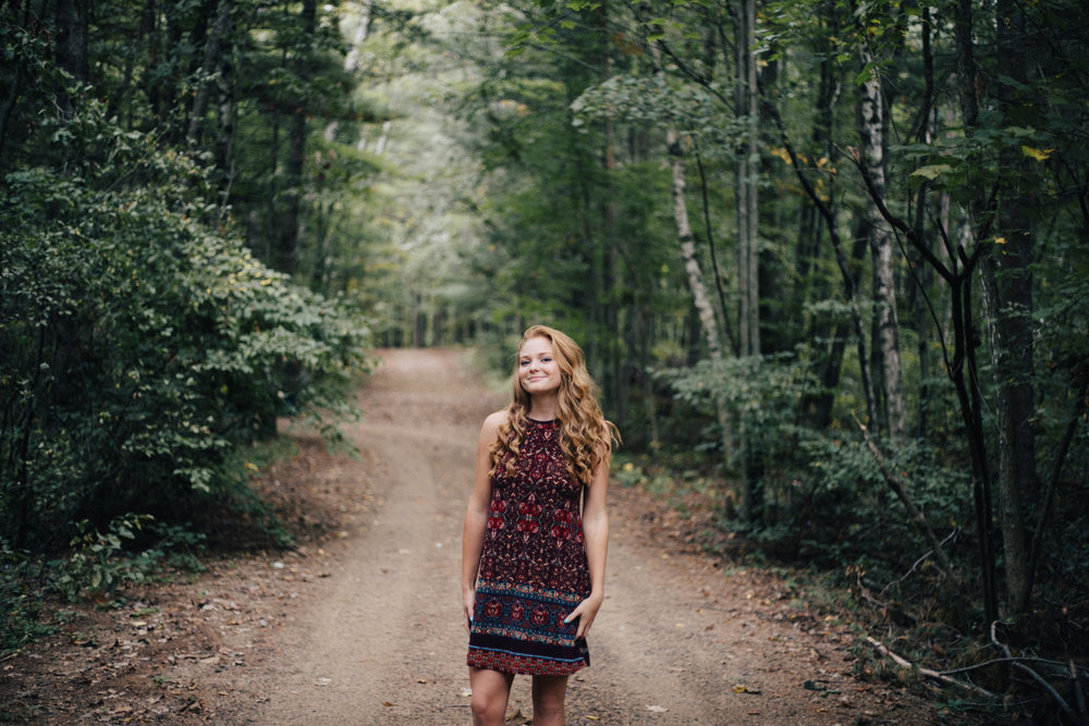 Senior portrait session in the northwoods of Brainerd Minnesota photographed by Britt DeZeeuw