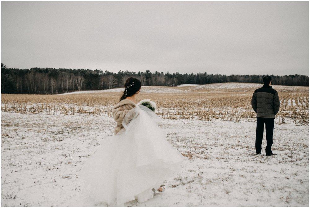 Snowy winter wedding at Pine Peaks in Crosslake Minnesota