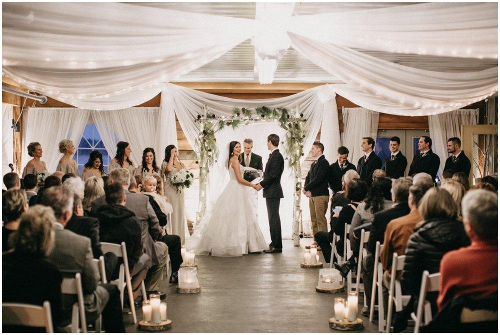 Pine Peaks candlelit wedding ceremony at sunset in Crosslake Minnesota