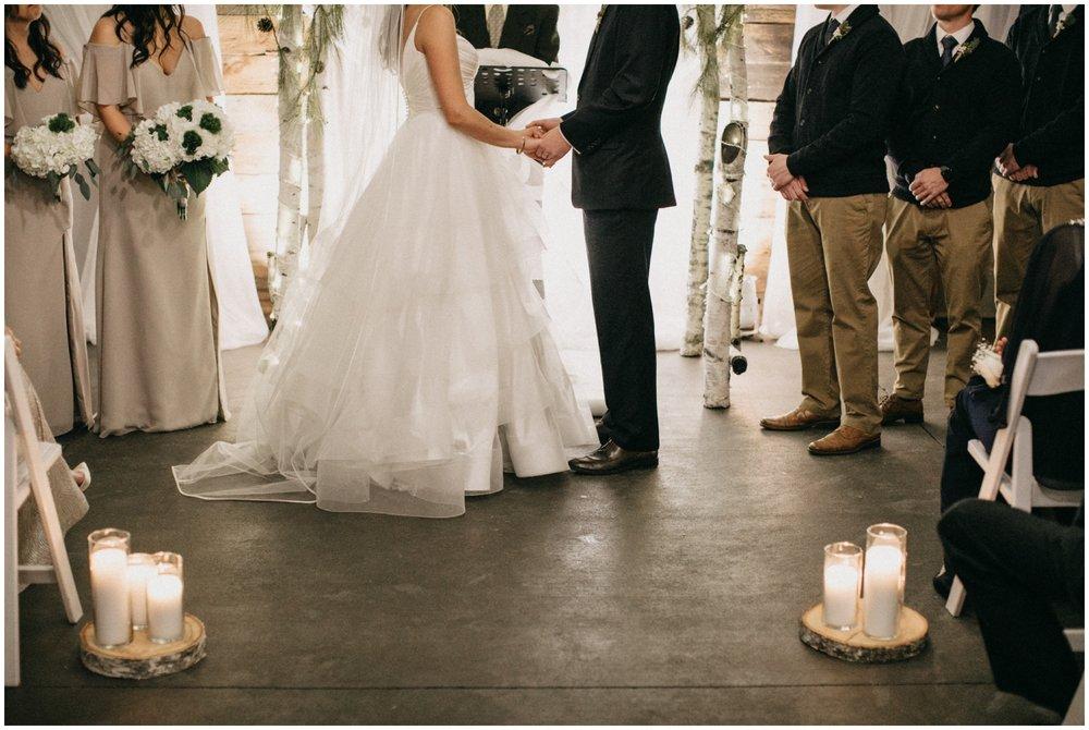 Romantic candlelit wedding ceremony at Pine Peaks in Crosslake Minnesota
