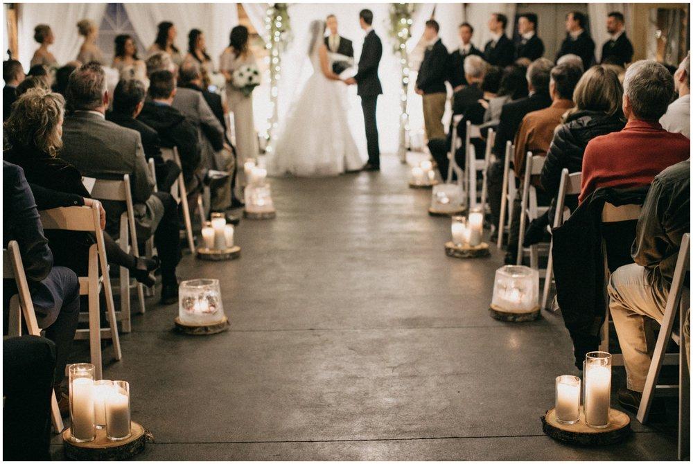 Whimsical winter wedding ceremony at Pine Peaks in Crosslake Minnesota