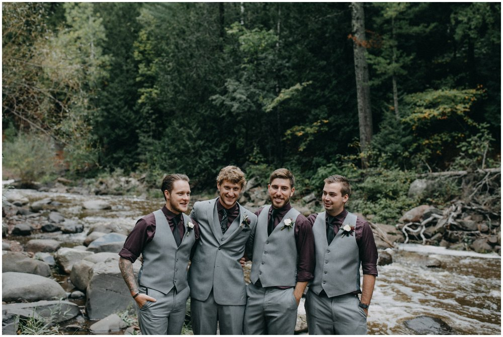 Groom with groomsmen at Duluth wedding in the woods