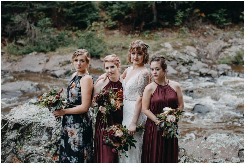 Bride with bridesmaids at destination waterfall wedding in Duluth Minnesota