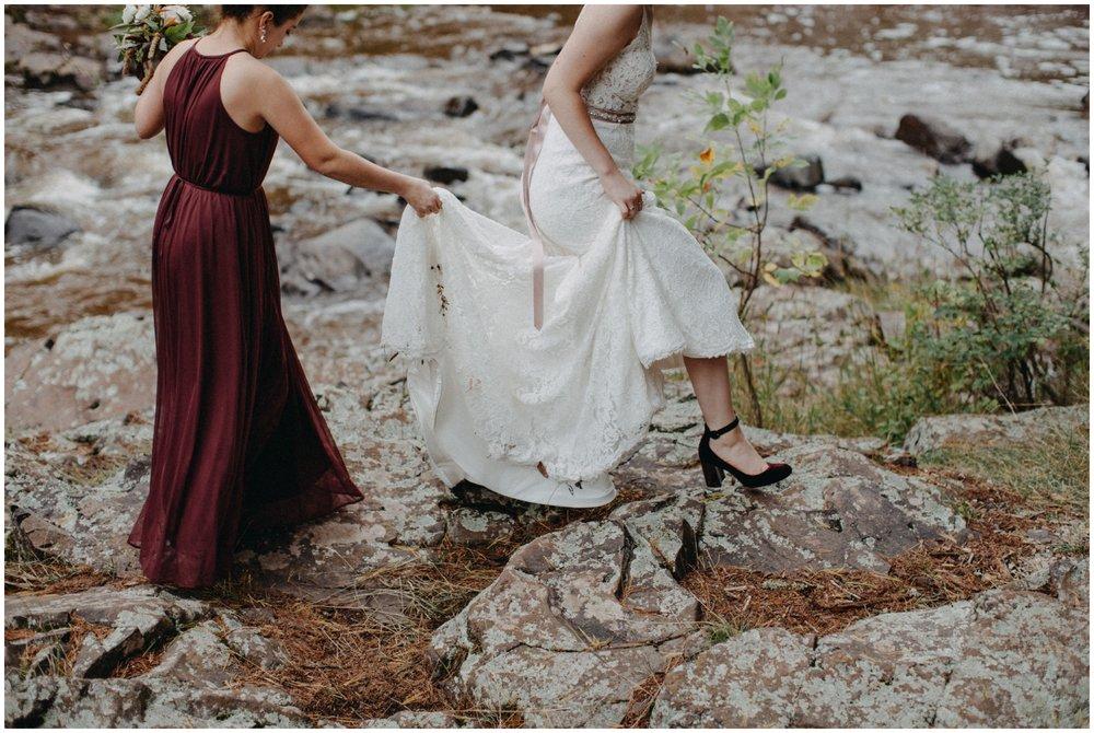 Bride walking with bridesmaid at Lester Park wedding