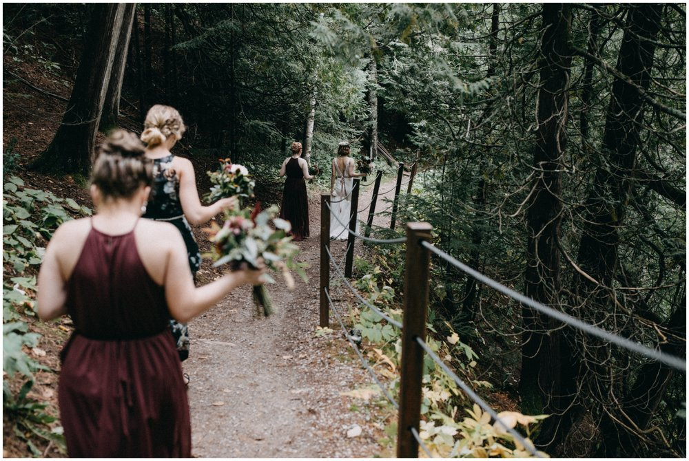 Bridemaids in woods at romantic Lester Park wedding