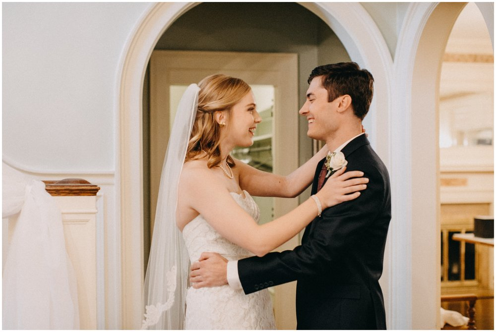 Documentary style portrait of bride and groom on wedding day at the St Paul College Club
