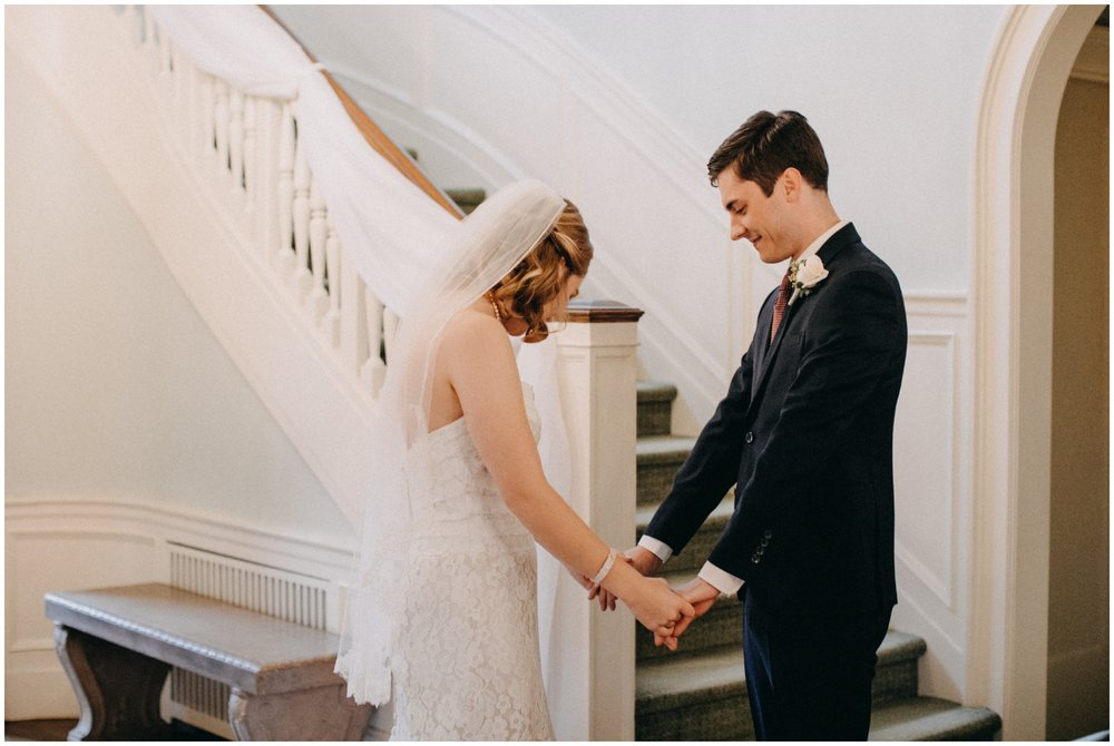Candid portrait of bride and groom on wedding day at the St Paul College Club