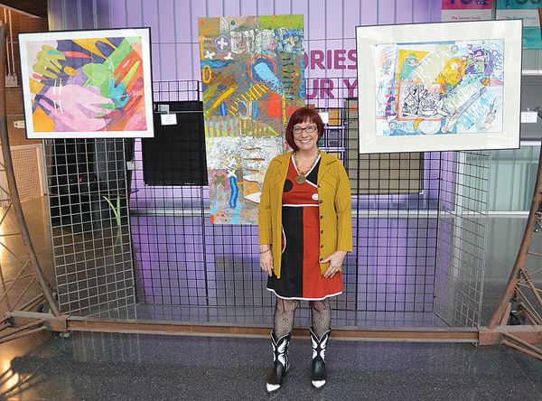 "Linda Allen at her one-woman show, ""Cheers,"" at the Boll Family YMCA, Detroit, 2015-16 (photo C&G News; full story: http://www.candgnews.com/news/local-artist-toast-downtown-%E2%80%98cheers%E2%80%99-89438)"