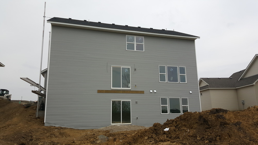 Rear Exterior Siding Going On - 4.21.2016.jpg
