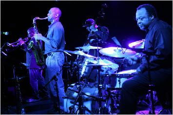 Christian McBride in back with, from left, Terence Blanchard, Branford Marsalis and the bandleader Jeff (Tain) Watts. (Hiroyuki Ito for The New York Times in 2009)