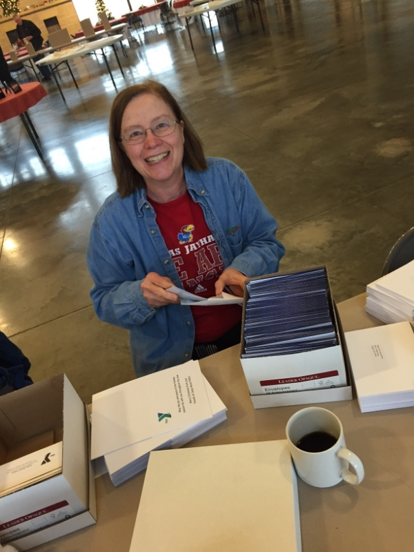 Margie Dyck, current Camp Wood YMCA board member and descendant of Stephen and Caroline Wood, helps with a Christmas card mailing earlier this December.