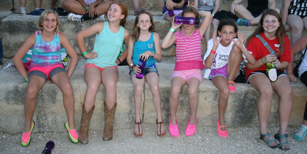 Lucia (2nd from left) and her cabin mates waiting for evening campfire to start.