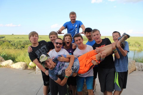 """Rainbow"" (Tyce) gets a lift from some campers this summer."