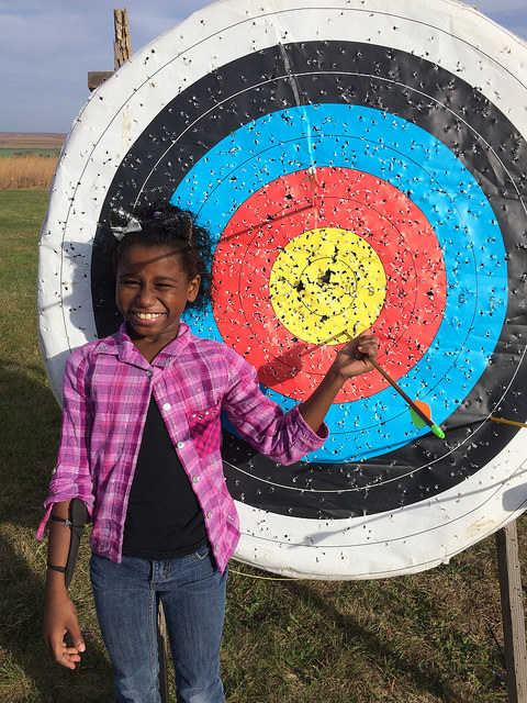 Families loved learning new skills at archery during last year's Harvest Family Camp.