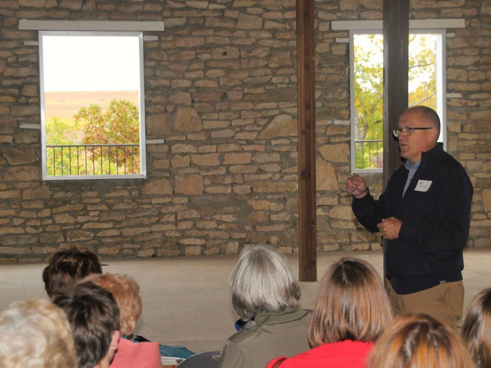 Ken speaks with visitors during Hutch Hall's renovation. The old wooden backstage was removed and the original views to the hills beyond was restored.