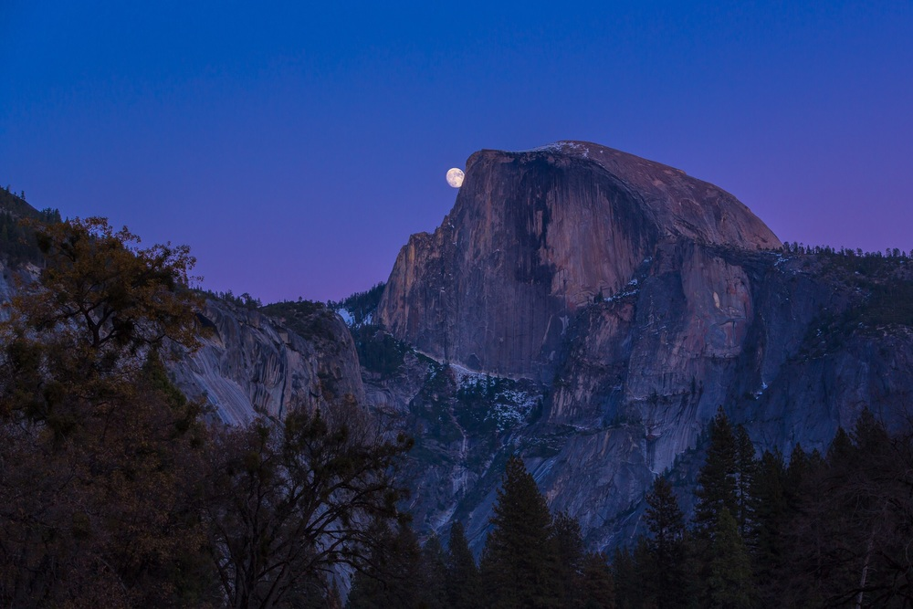 A nearly full moon kisses Half Dome goodnight.