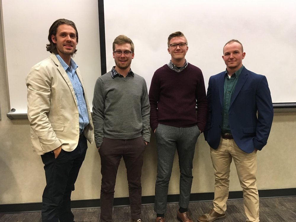 GrandPR staff Tom Crawford, Evan Clark, Hunter Burin, and Riley Holbrook pose for the camera to show their take on business casual attire.