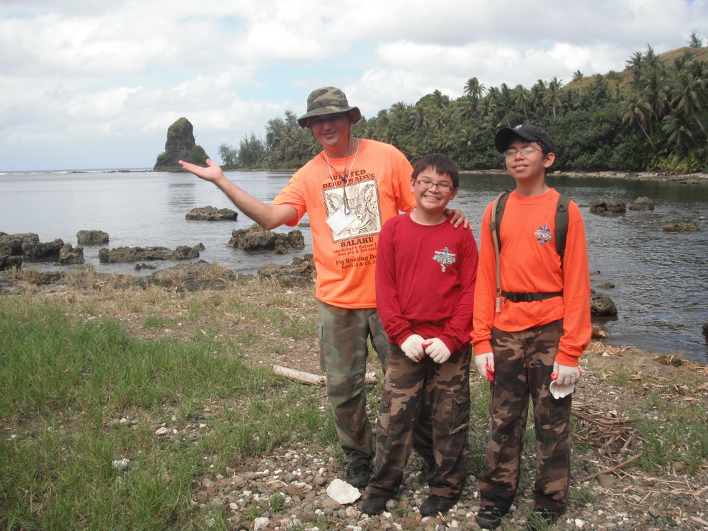 Terrestrial Biologist, Jeff Quitugua, and sons