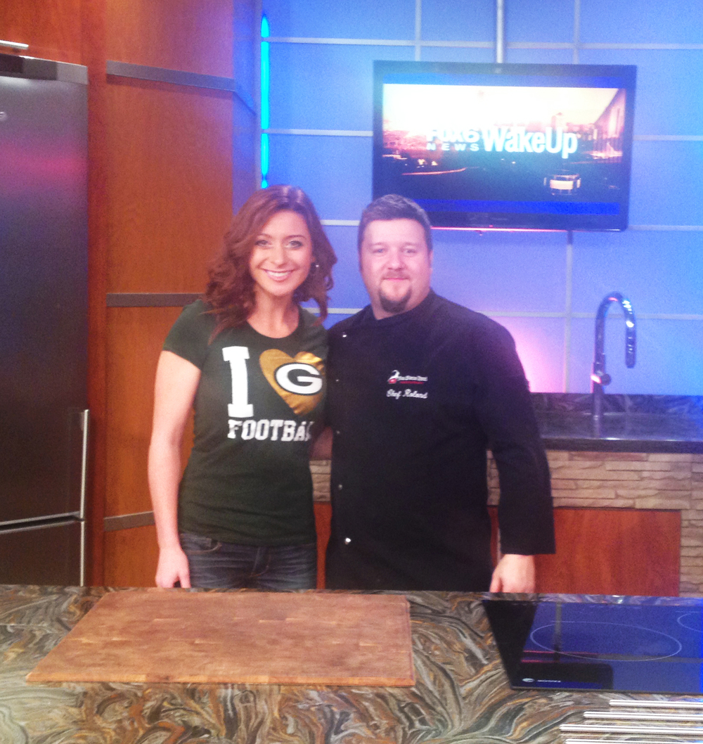 Discover Wisconsin host, Mariah Haberman, and Chef Roland Fürst promoting Discover Wisconsin's Cheesemaking Show, featuring the New Glarus Hotel Restaurant. LIVE on Fox 6 News—10 a.m., November 17, 2014.