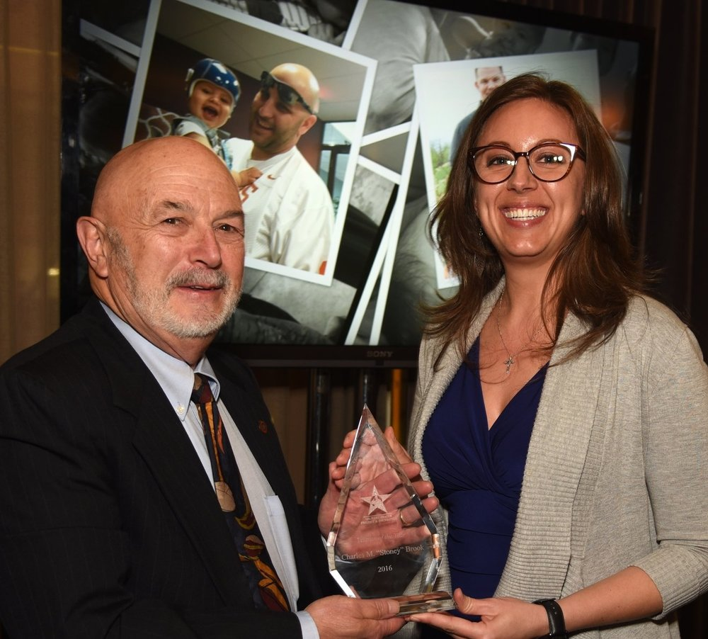 "MHPF Board Member Nicolette Lee, presents Charles M. ""Stoney"" Brook with the 2016 Veteran of the Year Award."