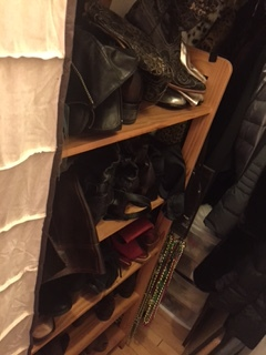 Boots in an old bookcase behind the shoes