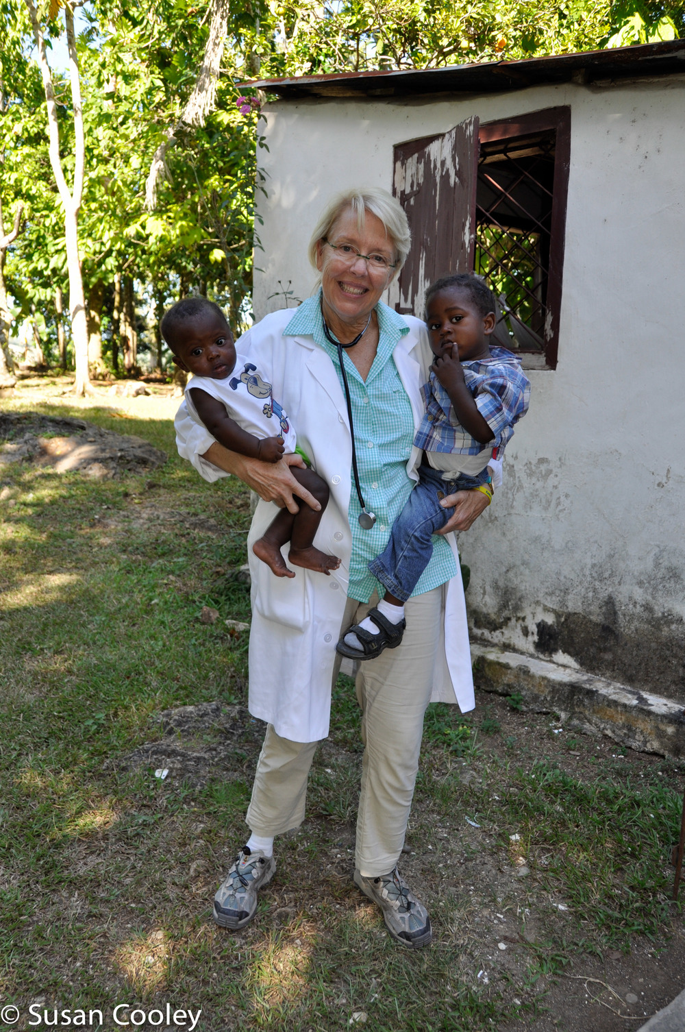 Susan with Haitian patients, 2013.