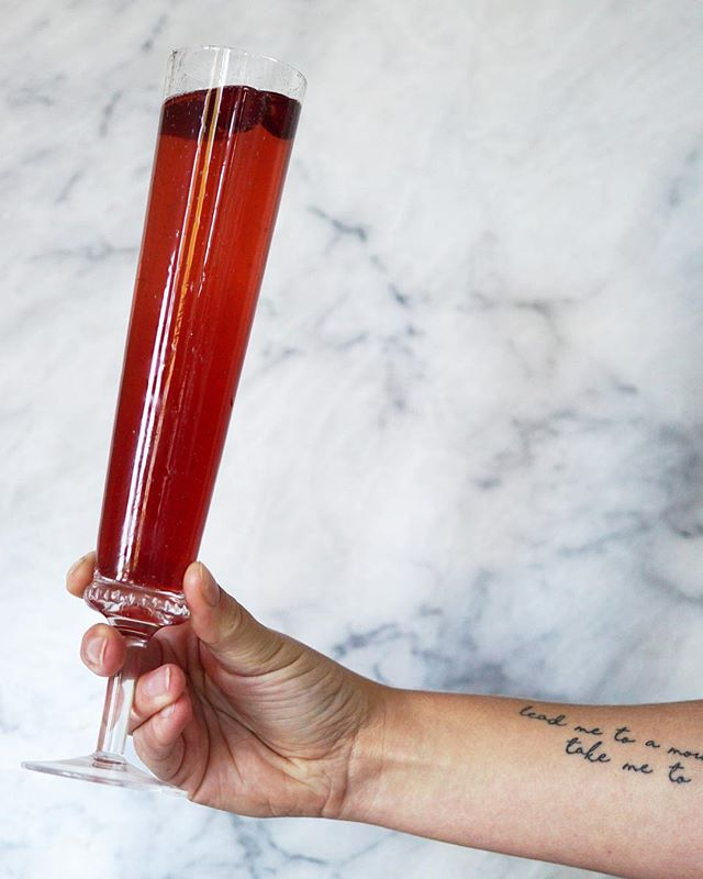 I don't host an event without booze 😉 This Saturday at the @stockedgeneral Holiday Market, we'll have cranberry-prosecco cocktails and wine for you to sip on while you shop! Please come drink with me! (@anthropologie flute not included.)⠀ .⠀ .⠀ #cocktails #holidays #holidaymarket #seattle #ballard