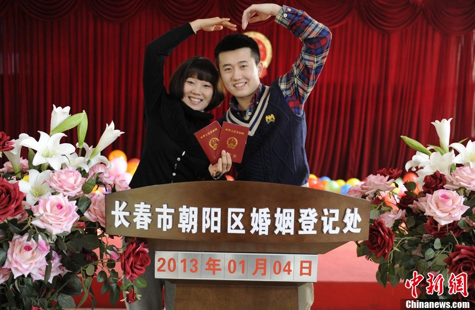 "Couples rushed to get married on ""love you forever"" day (January 4, 2013-- or 13/1/4, which sounds phonetically like ""love you forever"" in Chinese)"